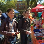 Two students visit the OSU Folk Club booth during Beaver Fair