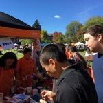 Students visit the OSU Folk Club booth during Beaver Fair